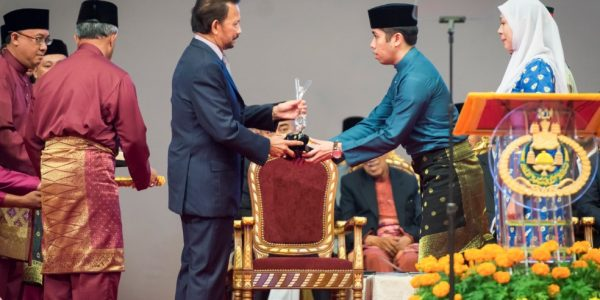 His Majesty Presents Youth Leader Award to Anwar Mohammad